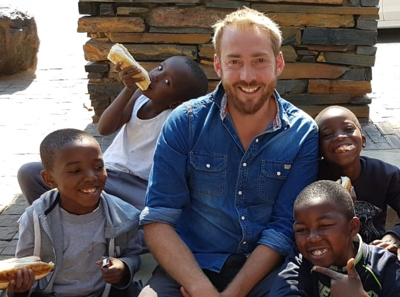 Richard Langmead sits with a group of local lads during a recent mission trip to South Africa